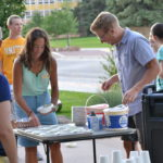 The Rodgers serving students ice cream.